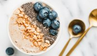 Top view of a smoothie bowl with fresh ripe blueberry